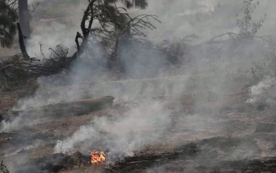 Scores of wildfires in western U.S. rage on